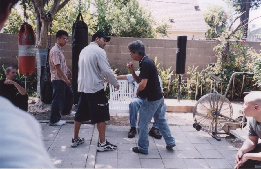 2004 Los Angeles, Ernie Barrios, Hawkins Cheung, Gary Lam (sitzend)